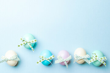 Easter background blue. Colourful egg with tape ribbon on pastel blue background in Happy Easter...
