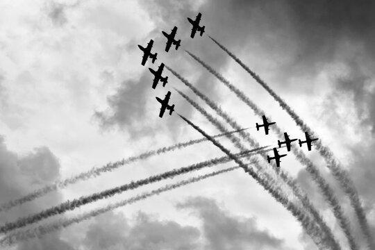Two aerobatic squadron in close proximity in the sky
