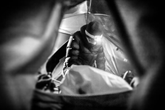 A person working within the tent