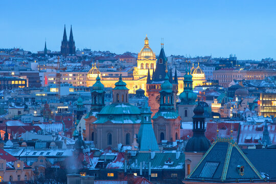 Prague - Spires of the Old town and illuminated National museum.