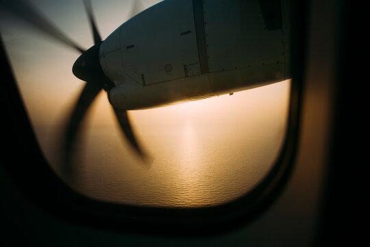 Sunrise seen through the window of an airplane