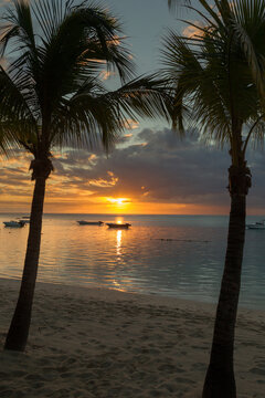 Sunset over the Indian Ocean near Le Morne on the west coast of Mauritius, Africa.