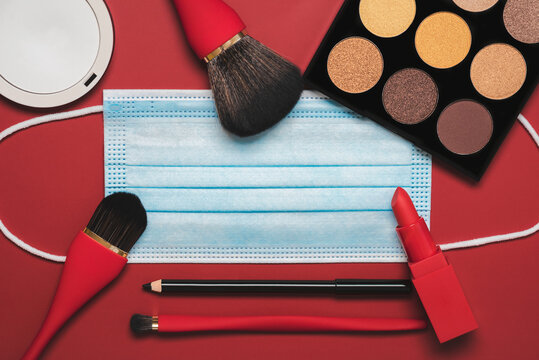 Flat lay of protective surgical mask with female cosmetics and accessories.Make Up Beauty Fashion Concept