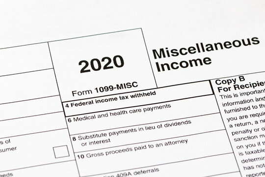 1099 miscellaneous income tax form. Concept of income taxes and federal tax information.