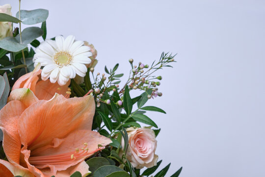 Fresh bunch of pink lilies, chamomile and roses with copy space
