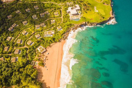 Aerial view of a luxury resort facing the Ocean with waves crashing on the beach on a paradise island, María Trinidad Sánchez, Dominican Republic.