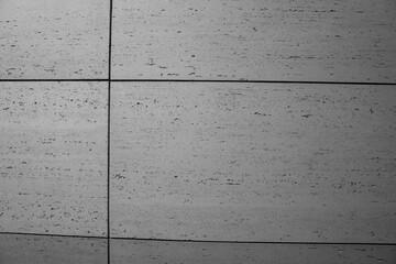 betonowa nowoczesna ściana pokryta szarymi betonowymi płytkami w stylu modern lub loft
