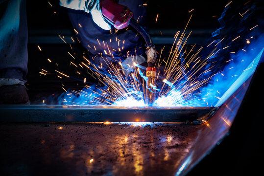 The welder is welding steel plates