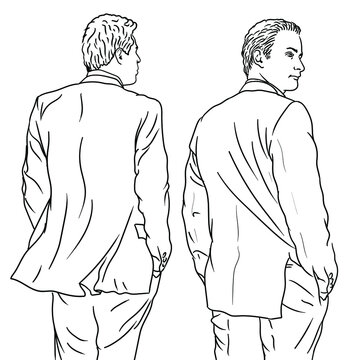 A young man in a classic suit stands with his back turned.