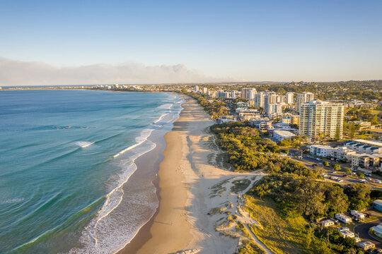 Aerial view of Maroochydore promenade skyline with a paradise beach facing the blue water of Coral Sea at sunset, Queensland, Australia.