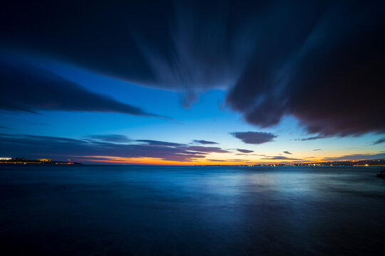 Beautiful seascape in twilight. Photo on long exposure of sea surface after sunset in evening.