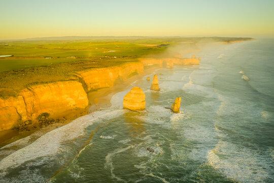 Aerial view of Twelve Apostles, a famous landscape along the Australian south coastline near Marine national park at sunset, Victoria, Australia.