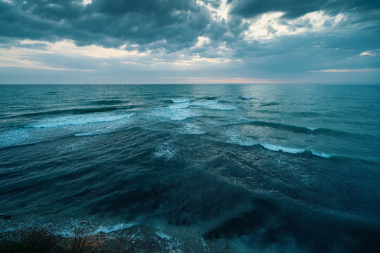 Sea or Ocean Dramatic Seascape Panorama in dark blue moody colors.