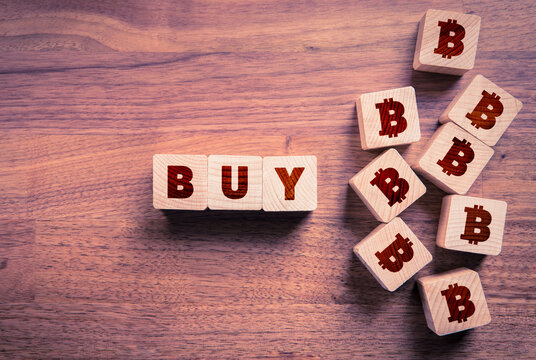Buy bitcoin concept with wooden cubes