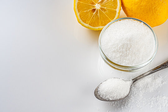 citric acid on a white acrylic background