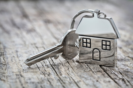 House key on a house shaped keychain background