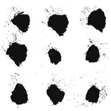 Schwarze Flecken, Kleckse und Farbspritzer auf weißem Hintergrund