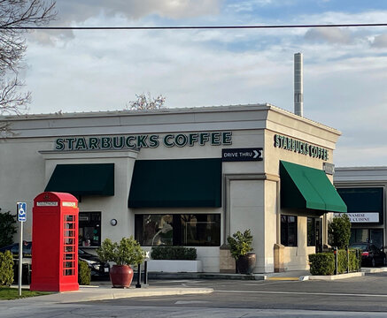 FRESNO, UNITED STATES - Feb 13, 2021: Photo of Starbucks Coffee building outside on a sunny day