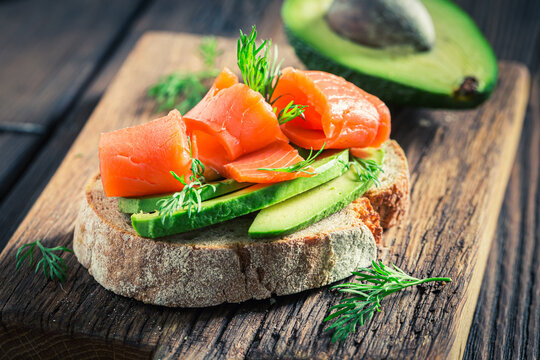Healthy bread with salmon, dill and avocado