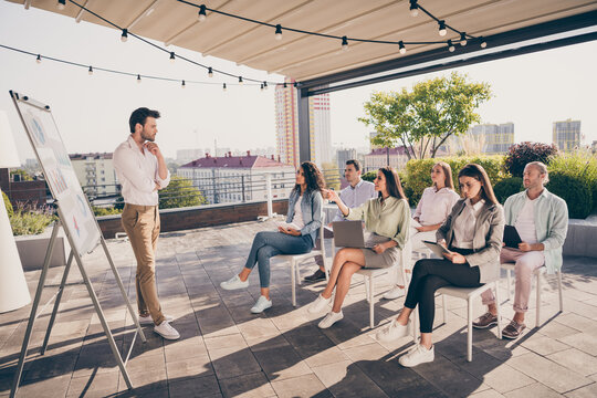 Full size photo of young man leader boss thinking about question having meeting with colleagues outside outdoors
