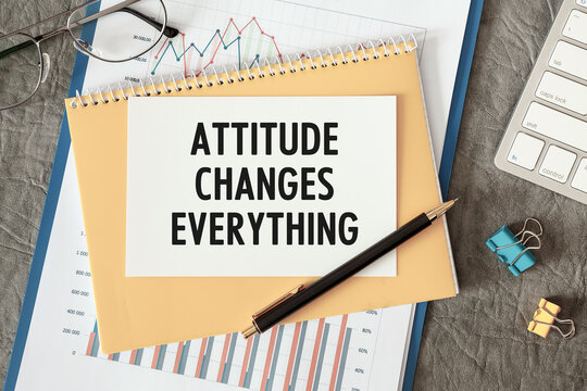 Attitude Changes Everything is written in a document on the office desk