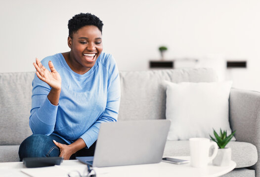 Black woman having video call using computer and gesturing