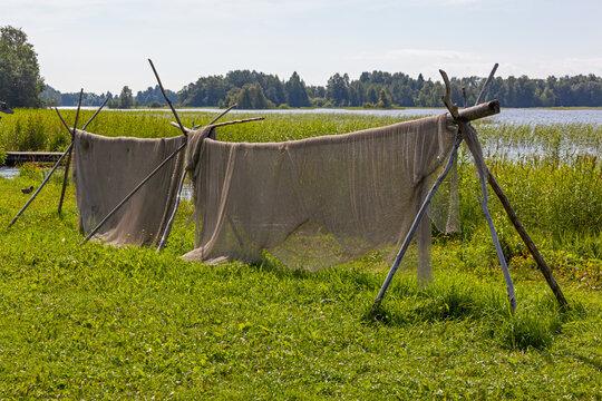 Fishihg nets dry on the bank of Onega lake on the Kizhi island, Karelia, Russia