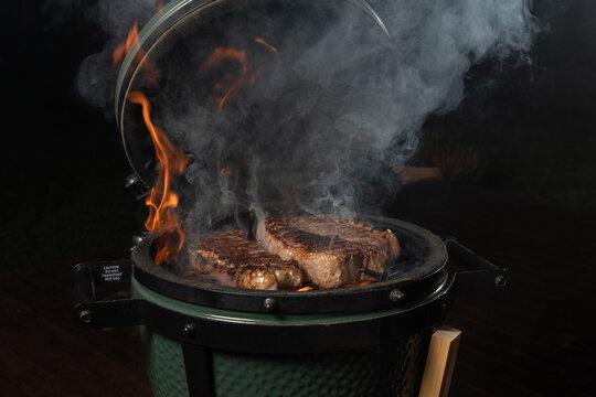 Smoky new york steak on egg type grill