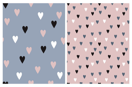 Cute Hand Drawn Irregular Hearts Vector Patterns. White, Black, Pink and Blue Hearts on a Light Pink and Pale Blue Background. Funny Romantic Infantile Style Print. Love Symbol.