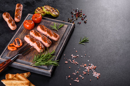 Tasty, fresh sausages grilled with vegetables spices and herbs