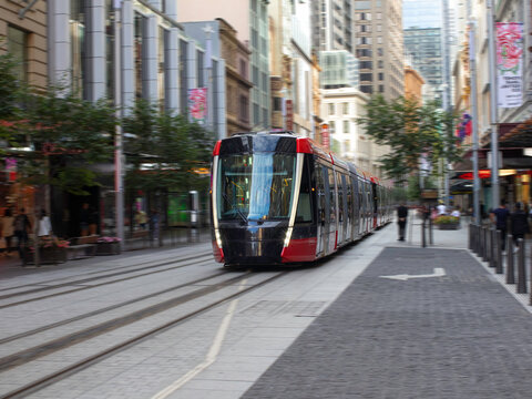 Tram moving through George St in Sydney NSW Australia