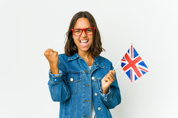 Young latin woman holding a english flag isolated on white background