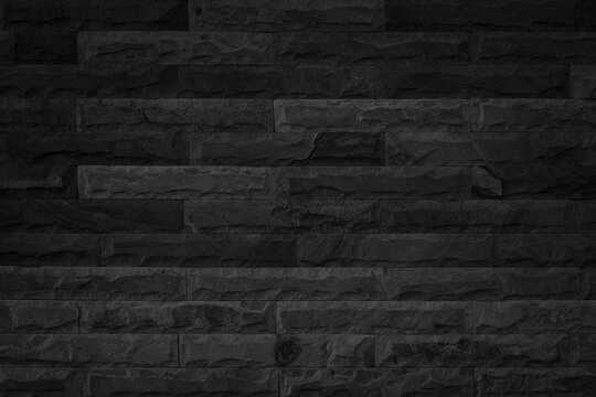 Abstract dark brick wall texture background pattern, Empty brick wall  surface texture. Brickwork painted black color interior old blank concrete grid uneven, Home office design backdrop decoration.