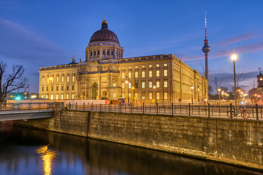 The imposing rebuilt Berlin City Palace with the Television Tower at dawn