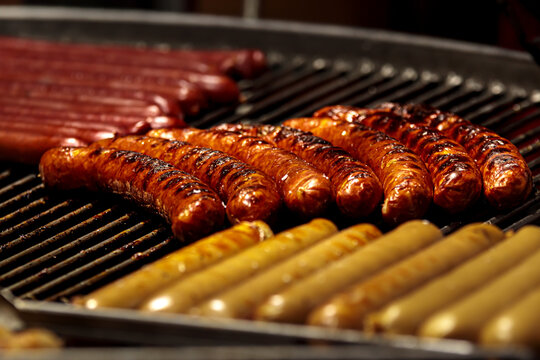 Barbeque sausage. Bbq grill pork bratwurst. Barbecue kielbasa, hot picnic dinner. Beef hotdog, party food, italian or grrman roasted snak. Outdoor fest, family cook for breakfast
