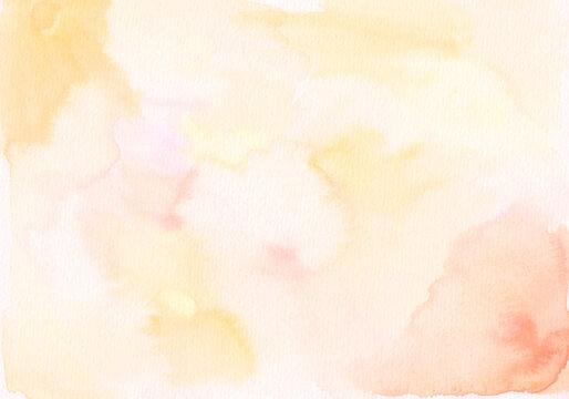 オレンジ色のやわらかい水彩背景素材