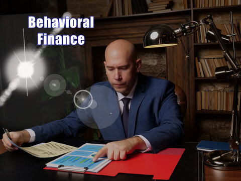 Conceptual photo about Behavioral Finance Businessman, executive manager hand filling paper business document