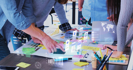 Fototapeta Close up ux developer and ui designer use augmented reality app brainstorming about mobile interface wireframe design on desk at modern office.Creative digital development agency obraz