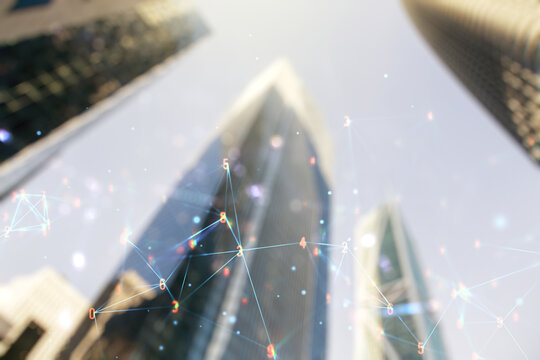 Double exposure of abstract virtual technology hologram on modern skyscrapers background. Research and development software concept