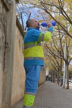 sweeper in uniform drinking water