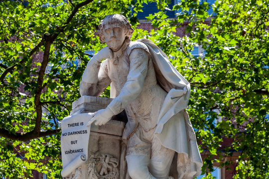 William Shakespeare marble statue erected in 1874 in Leicester Square Gardens London England UK which is a popular tourist travel destination attraction landmark, stock photo image