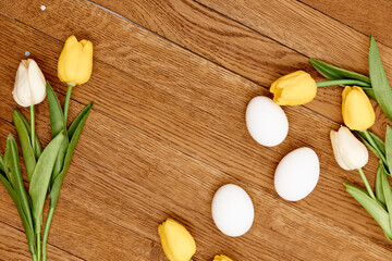 tulip easter eggs wooden background top Copy Space