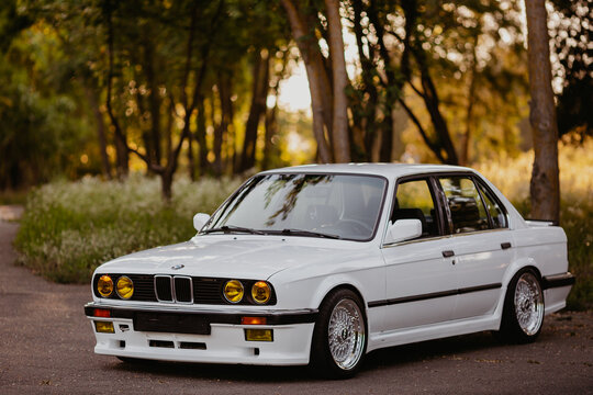 Berlin, Germany - July 07, 2020: Original BMW M3 e30 outdors, BBS wheels, tunning M Tech, glossy and shiny old classic retro oldtimer.