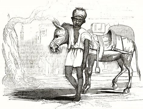 Young Egyptian donkey driver outdoor posing to front hugging his animal. Ancient grey tone etching style art by Sears, Magasin Pittoresque, 1838