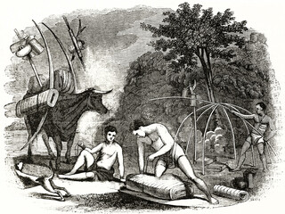 Fototapeta South African Griqua indigenous people refolding tents and preparing the depart outdoor in african nature. Ancient grey tone etching style art by Auvray, Magasin Pittoresque, 1838 obraz