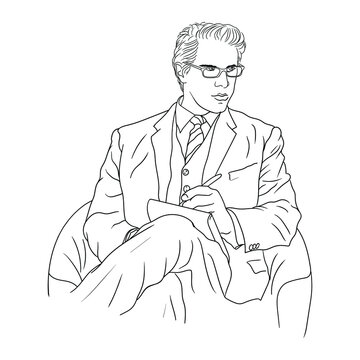 Business man in a suit with glasses sits in an armchair and makes notes in a notebook.