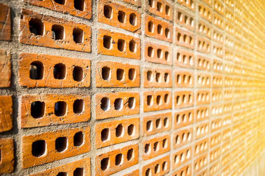 Closeup red brick wall with vintage warm light, wall design, industry and construction concept background