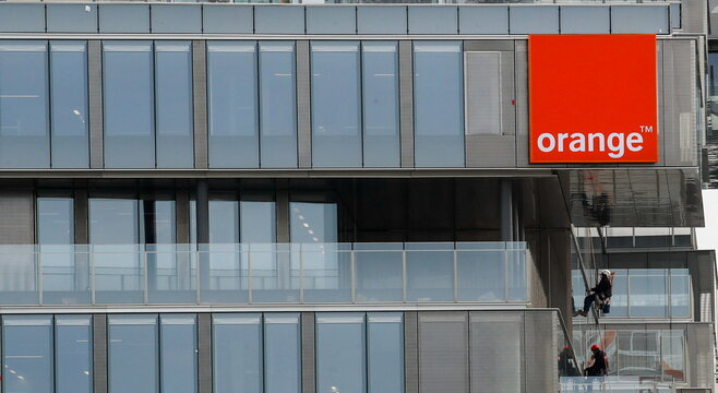 The logo of French telecom operator Orange is seen in Issy-les-Moulineaux near Paris