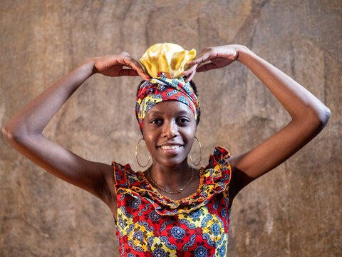 African American woman in national costumes of Republic of Congo posing in studio with vegetables