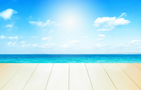Beautiful beach with white sand in sunny summer day. Turquoise ocean water and blue sky with clouds . Natural background for summer vacation, soft focus, space for text